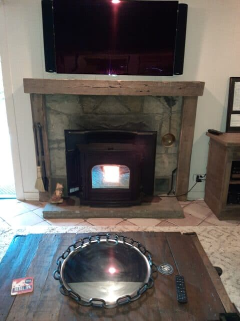 wood pellet insert with rustic surround and mantle