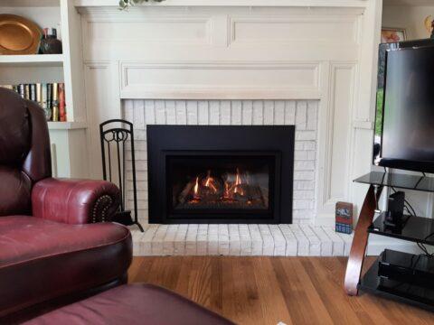 chaska 29 gas insert with white brick surround and hearth