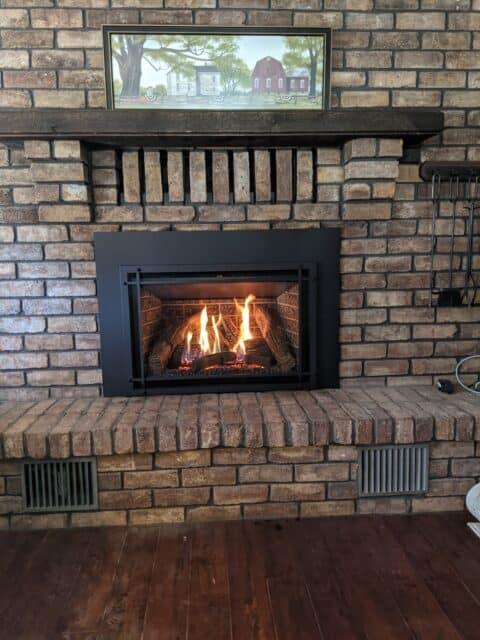gas insert with original brown brick hearth