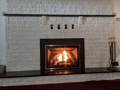 white brick fireplace with chaska 34 insert