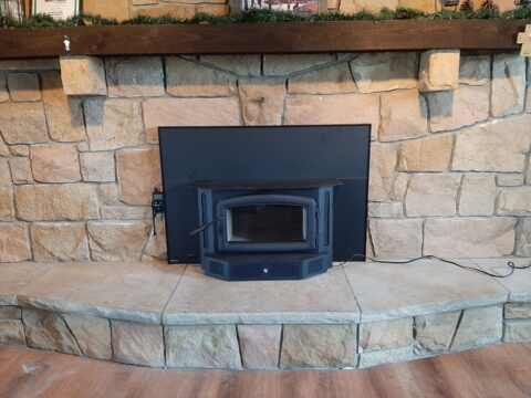 pellet insert install with stone surround and hearth