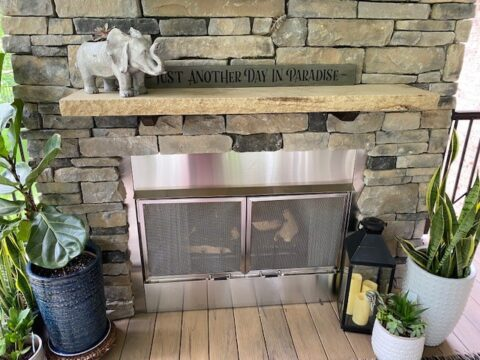 outdoor gas fireplace with stone surround